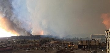 Residents flee Fort McMurray as wildfire moves downtown