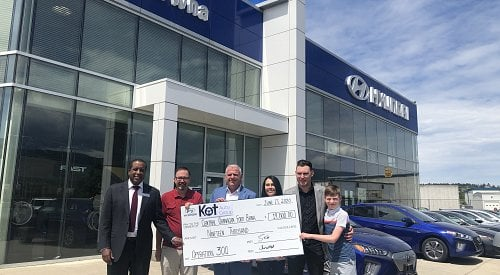 KOT Auto Group makes a $19,000 donation to the Central Okanagan Food bank.